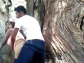 Guy fucking girl outdoor